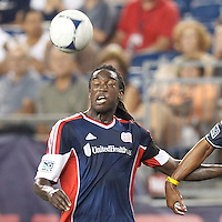 New England Revolution substitute midfielder Shalrie Joseph (21) heads the ball. In a Major League Soccer (MLS) match, Toronto FC defeated New England Revolution, 1-0, at Gillette Stadium on July 14, 2012.