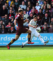 Pictured: Pablo Hernandez (R).<br /> Saturday 04 May 2013<br /> Re: Barclay's Premier League, Swansea City FC v Manchester City at the Liberty Stadium, south Wales.