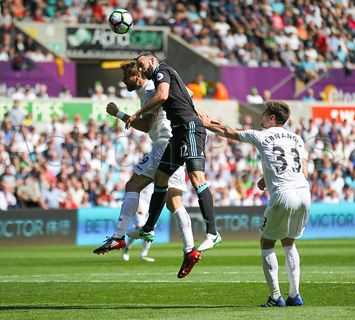May 21st 2017, Liberty Stadium, Swansea Wales;  EPL Premier league football, Swansea versus West Bromwich Albion; Fernando Llorente of Swansea City and Marc Wilson of West Bromwich Albion challenge for the ball during the match