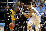 05 January 2015: Notre Dame's Jerian Grant (22) and North Carolina's J.P. Tokoto (13) reach for a loose ball. The University of North Carolina Tar Heels played the University of Notre Dame Fighting Irish in an NCAA Division I Men's basketball game at the Dean E. Smith Center in Chapel Hill, North Carolina. Notre Dame won the game 71-70.