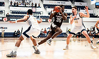 WASHINGTON, DC - JANUARY 5: Justin Winston #35 of St. Bonaventure breaks past Jamison Battle #10 of George Washington during a game between St. Bonaventure University and George Washington University at Charles E Smith Center on January 5, 2020 in Washington, DC.
