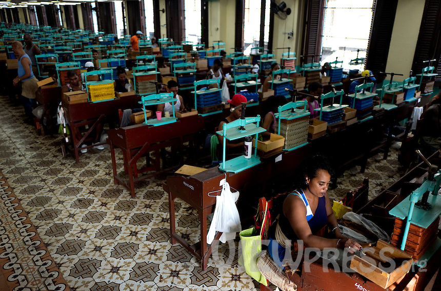 A woman rolls a cigar at the H. Upmann cigar factory in Havana, Cuba, March 01, 2017. Tourists from around the world visit to Cuba during the annual festival of the cigar, celebrate from February 27 to 3 of March.  VIEWpress/Eliana Aponte.