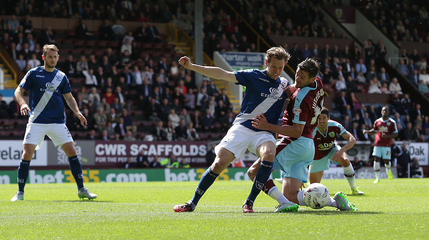 Burnley's Lukas Jutkiewicz battles with Birmingham City's Jonathan Spector <br /> <br /> Photographer Stephen White/CameraSport<br /> <br /> Football - The Football League Sky Bet Championship - Burnley v Birmingham City - Saturday 15th August 2015 - Turf Moor - Burnley<br /> <br /> &copy; CameraSport - 43 Linden Ave. Countesthorpe. Leicester. England. LE8 5PG - Tel: +44 (0) 116 277 4147 - admin@camerasport.com - www.camerasport.com