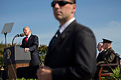 A member of the United States Secret Service stands watch while U.S. President Donald J. Trump, left, speaks during a ceremony to commemorate the September 11, 2001 terrorist attacks, at the Pentagon in Washington, D.C., U.S., on Monday, Sept. 11, 2017. Trump is presiding over his first 9/11 commemoration on the 16th anniversary of the terrorist attacks that killed nearly 3,000 people when hijackers flew commercial airplanes into New York's World Trade Center, the Pentagon and a field near Shanksville, Pennsylvania.<br /> Credit: Andrew Harrer / Pool via CNP