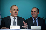 Israeli Prime minister Benjamin Netanyahu (L) talks as he sits next to Intel CEO Brian Krzanich during a press conference with Mobileye co-founders at the Prime Minister's Office in Jerusalem on March 14, 2017. US giant Intel announced it would buy Israeli car tech firm Mobileye for more than $15 billion (14 billion euros), the largest cross-border tech deal in the Jewish state's history. Photo by: JINIPIX