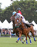 WELLINGTON, FL - MARCH 26:  Valiente's Adolfo Cambiaso (white jersey) takes control of the ball as Valiente defeats Coca Cola 9-6 in the final of the 26 goal USPA Gold Cup, at the International Polo Club, Palm Beach on March 26, 2017 in Wellington, Florida. (Photo by Liz Lamont/Eclipse Sportswire/Getty Images)
