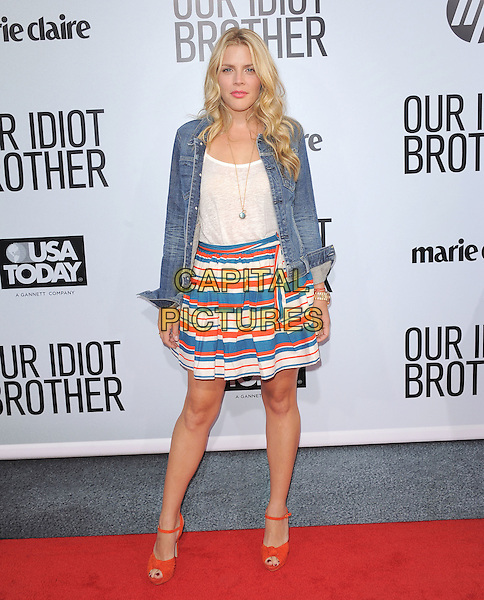 "Busy Phillips.""Our Idiot Brother"" Los Angeles Premiere held at Arclight Cinemas, Hollywood, California, USA..August 16th, 2011.full length white red ankle strap peep toe shoes top striped stripes skirt white blue jean denim                                        .CAP/RKE/DVS.©DVS/RockinExposures/Capital Pictures."