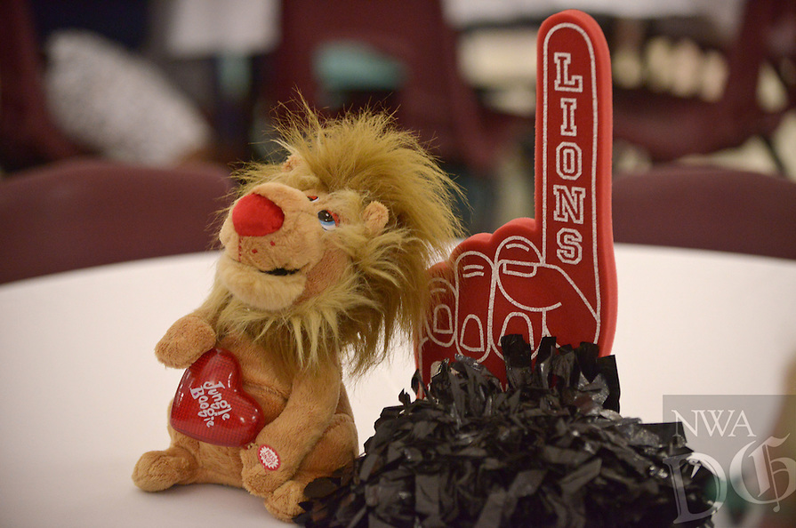 NWA Democrat-Gazette/BEN GOFF @NWABENGOFF<br /> A school spirit centerpiece decorates a table on Monday Jan. 16, 2017 during a 20th anniversary celebration at the school in Rogers. The school opened with just 6th grade in the fall of 1996, with 7th graders arriving in Jan. of 1997. Since Aug. 2008 the school has also had 8th grade.