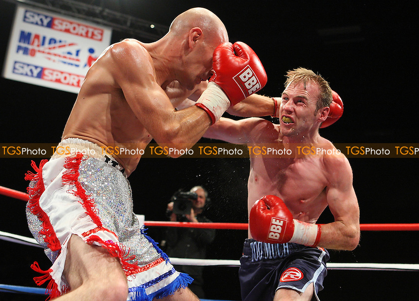 Stuart Hall (white shorts) defeats Martin Power in a bantamweight Boxing contest at the Brentwood International Centre, promoted by Maloney Promotions - 11/09/09 - MANDATORY CREDIT: Gavin Ellis/TGSPHOTO - Self billing applies where appropriate - Tel: 0845 094 6026
