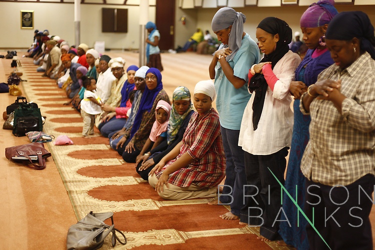 People pray after a fast for Ramadan at Atlanta Masjid of Al-Islam and then enjoy a meal prepared by mosque members in Atlanta, Georgia September 7, 2010.