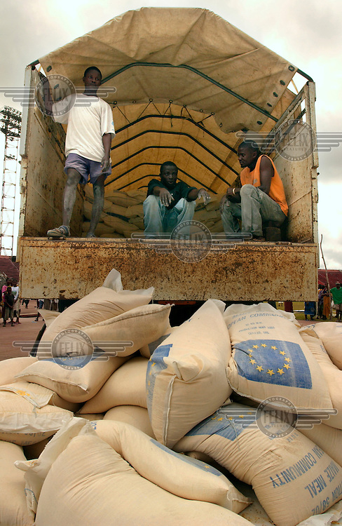Red Cross (ICRC) workers unload food from trucks at the Samuel K Doe stadium, where about 15,000 internally-displaced people (IDPs) had taken refuge..The ongoing conflict in Libera intensified in March 2003 when rebels opposed to the government of Charles Taylor gained territory across much of the country, advancing on the capital city Monrovia. In August 2003 Taylor agreed to hand over power to an interim government and went into exile in Nigeria, which led to the signing of a peace agreement. Taylor was indicted for war crimes by a UN court in Sierra Leone, accused of fuelling conflict across several West African countries.