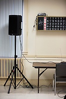 A speaker is seen next to a Bingo number board at an event featuring political candidates put on by Chelsea Black Community at the Chelsea Senior Center in Chelsea, Massachusetts, USA, on Wed., June 27, 2018.