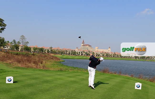Romain Wattel (FRA) tees off the 9th tee during Sunday's Final Round of the 2014 BMW Masters held at Lake Malaren, Shanghai, China. 2nd November 2014.<br /> Picture: Eoin Clarke www.golffile.ie
