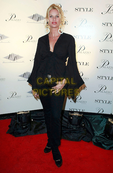 NICOLLETTE SHERIDAN.Celebrities arrive at the 40/40 Club after the Palazzo Grand Opening at Barneys New York and the Shoppes at the Palazzo, Las Vegas, Nevada, USA,.17 January 2008..full length black top trousers tied sleeves Nicolette.CAP/ADM/MJT.©AdMedia/Capital Pictures.