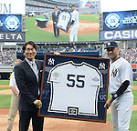 (L-R) Hideki Matsui, Derek Jeter (Yankees),<br /> JULY 28, 2013 - MLB :<br /> Hideki Matsui poses with a framed number 55 jersey and Derek Jeter of the New York Yankees after receiving it from him during his official retirement ceremony before the Major League Baseball game against the Tampa Bay Rays at Yankee Stadium in The Bronx, New York, United States. (Photo by AFLO)