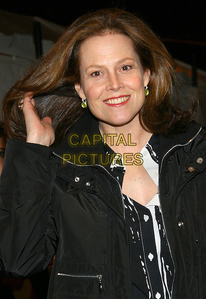 SIGOURNEY WEAVER.NY premiere of Brokeback Mountain, New York, NY.  .December 6th, 2005.Photo: Jackson Lee/Admedia/Capital Pictures.Ref: JL/ADM.half length gesture hand in hair green earrings.www.capitalpictures.com.sales@capitalpictures.com.© Capital Pictures.