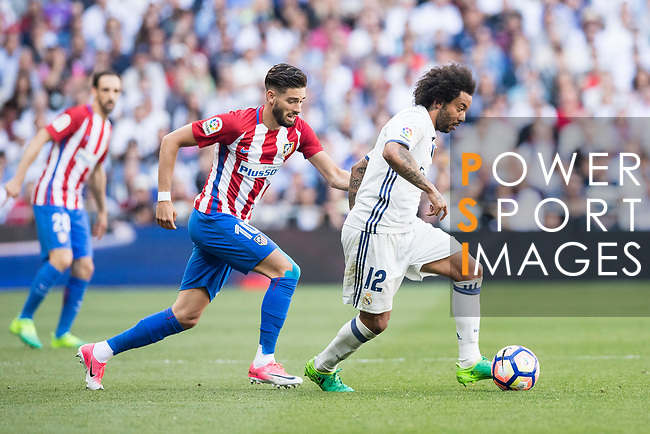 Marcelo Vieira Da Silva of Real Madrid is followed by Yannick Ferreira Carrasco of Atletico de Madrid during their La Liga match between Real Madrid and Atletico de Madrid at the Santiago Bernabeu Stadium on 08 April 2017 in Madrid, Spain. Photo by Diego Gonzalez Souto / Power Sport Images