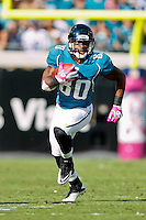 October 03, 2010:  Jacksonville Jaguars wide receiver Mike Thomas (80) runs after catching a pass during 1st half AFC South Conference action between the Jacksonville Jaguars and the Indianapolis Colts at EverBank Field in Jacksonville, Florida.   Jacksonville defeated Indianapolis 31-28........