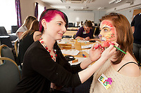 Staff experienced an unsual induction training day for the soon to be opened Derby Hobbycraft store. Here Angela Derrett face paints Elise Nichol