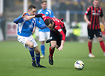 Queen of the South v St Johnstone...07.02.15    Scottish Cup 5th Round<br /> James McFadden is sent flying by Paul Burns<br /> Picture by Graeme Hart.<br /> Copyright Perthshire Picture Agency<br /> Tel: 01738 623350  Mobile: 07990 594431
