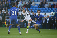 Andre Schurrle of Fulham (C) scores the opening goal while closely marked by Harry Arter of Cardiff City (R) during the Premier League match between Cardiff City and Fulham FC at the Cardiff City Stadium, Wales, UK. Saturday 20 October 2018