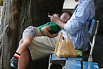 May 5, 2010 - Tokyo, Japan - A young boy sleeps in father's arm in a park in Tokyo, Japan, on May 5, 2010. The number of children aged under 15 in Japan has hit a record low of under 17 million, according to a government report released Tuesday. The child population is estimated to have dropped 190,000 from a year earlier to 16.94 million, marking the 29th consecutive annual decline. The report also showed that children's share of the nation's entire population stood at 13.3%, compared with 23% for a population of people aged over 65.