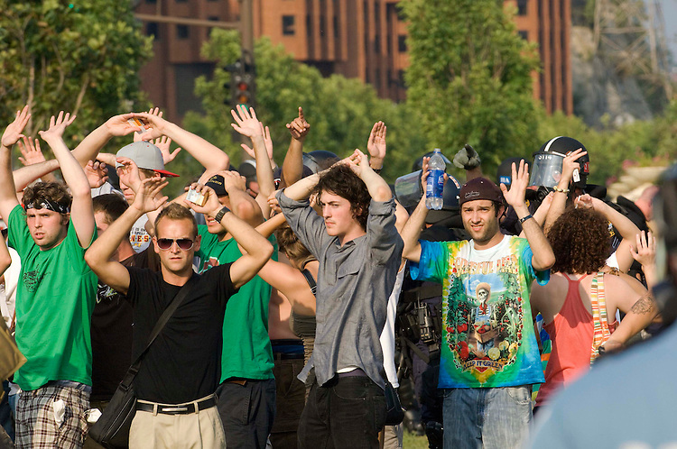 MINNEAPOLIS/ST. PAUL, MN:  Protesters in an area between the Xcel Center and the river were corralled by police and placed under temporary arrest as they refused to obey an order to disperse. The police then gathered the protesters, with media and onlookers mixed in, ordering them to place hands on heads, and escorted them to the perimeter of the area, telling them to exit west and not turn around.  (photo by Scott J. Ferrell/Congressional Quarterly Inc.)