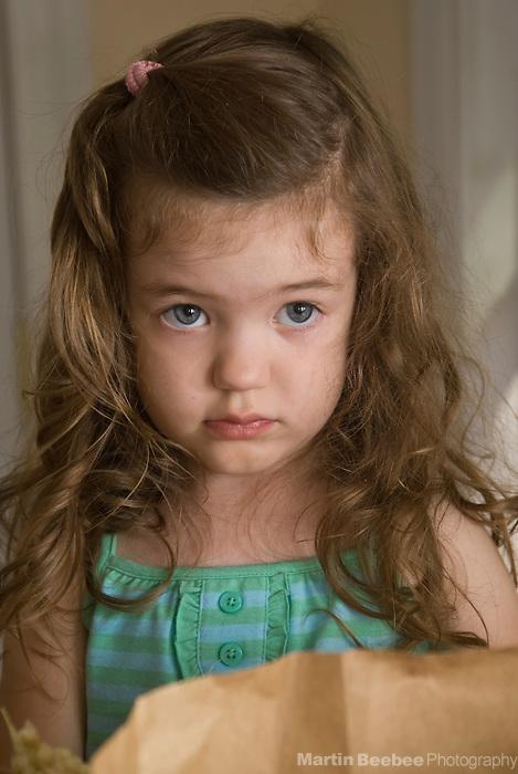 A sad-looking three-year-old girl