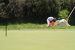 Rory McIlroy playing out of the bunker on the 5th.during round three of the BMW PGA championship 2010 at Wentworth golf club, Surrey England..Picture Fran Caffrey/Newsfile.ie