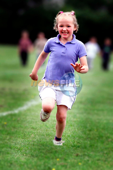 Jade McNally running in the Junior Infants Girls race at Tullyallen Sports Day which was sponsered by Siucra...Pictured are the pupils from Tullyallen National School, one of the many schools selected to take part in the Suicra Schools Sports Day initiative. the first of it's kind nationwide, the Siucra School Soprts Day initiative saw Siucra organise and sponser the annual sports day in 1800 national schools nationwide and involving 250,000 pupils. Pupils received stickers, certificates, exercise sheets, sugessted games and finishing lines as part of the initiative..Picture: Paul Mohan/Newsfile..PICTURED SUPPLIED BY NEWSFILE LTD. ON BEHALF OF EDELMAN PR..NO REPRODUCTION FEE