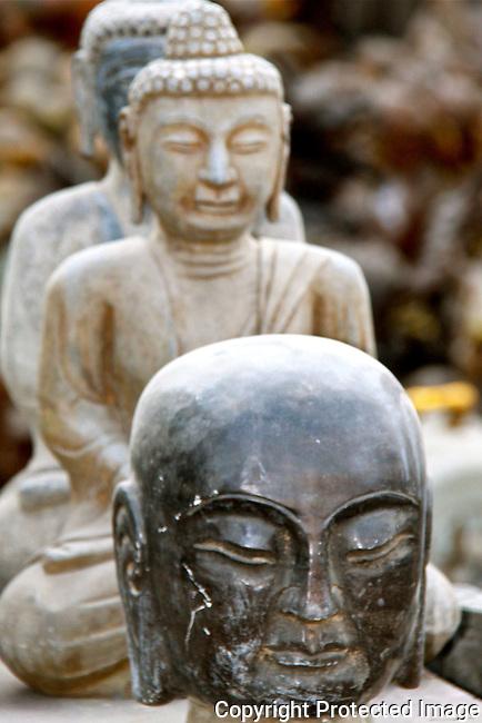 Asian stone statues peace religion faces harmony photo