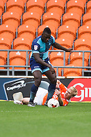 Aaron Pierre of Wycombe Wanderers tackles Mark Cullen of Blackpool during the Sky Bet League 2 match between Blackpool and Wycombe Wanderers at Bloomfield Road, Blackpool, England on 20 August 2016. Photo by James Williamson / PRiME Media Images.