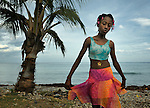"Romage Jean Louis, a member of Nouvel Etwal - Haitian Kreyol for ""New Stars"" - dances on the beach at Jacmel, Haiti. Nouvel Etwal is a dance and creative movement group of 16 girls from age 8 to 13, based in the southern village of Mizak. According to Valerie Mossman-Celestin, an organizer of the group, ""Nouvel Etwal seeks to empowers girls to be self-confident and creative. The girls learn flexibility, discipline and teamwork, lessons they also need for life. Nouvel Etwal promotes health, well-being and enhanced self-worth. The girls are encouraged to live into a brighter future where girls and women are valued,  educated, and have equal opportunity to achieve their potential."""