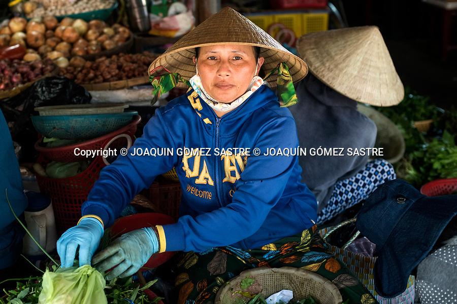 Portrait of a woman selling vegetables at Hoian Market (Vietnam)<br /> HOIAN-VIETNAM