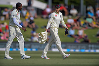 England's Jofra Archer chats with Joe Root during day two of the international cricket 1st test match between NZ Black Caps and England at Bay Oval in Mount Maunganui, New Zealand on Friday, 22 November 2019. Photo: Dave Lintott / lintottphoto.co.nz