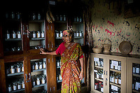 Bijadidi explains seeds and conservation as she stands in the seed bank in Dr. Vandana Shiva's farm in Dehradun, Uttarakhand, India on 5th September 2009. ..61 year old Bija Devi, affectionately known as Bijadidi, is the 'seed bank expert', and has worked with the organization since it was founded. She's known for her knowledge of indigenous seeds. ..Dr. Vandana Shiva is a physicist turned environmentalist who campaigns against genetically modified food and teaches farmers to rely on indigenous farming methods.. .Photo by Suzanne Lee / For The National
