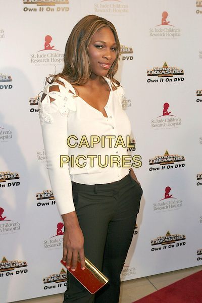 "SERENA WILLIAMS.3rd Annual Runway for Life Benefitting St. Jude Children's Research Hospital and Celebrating the DVD Release of ""National Treasure"" held at the Beverly Hilton Hotel, Beverly Hills, California, USA, 01st May 2005. .half length white cream cardigan flowers on shoulder clutch bag.Ref: ADM.www.capitalpictures.com.sales@capitalpictures.com.©Zach Lipp/AdMedia/Capital Pictures."