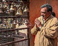 Nepal, Kathmandu.  Ringing Bells at Ashok Binayak (Maru Ganesh) Shrine.  Visit Ensures Safety on a Journey.