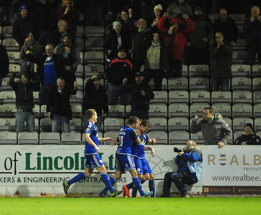 FC Halifax Town's Sam Walker celebrates scoring his sides first goal <br /> <br /> Photographer Andrew Vaughan/CameraSport<br /> <br /> Football - Vanarama National League - Lincoln City v FC Halifax Town - Saturday 26th December 2015 - Sincil Bank - Lincoln<br /> <br /> &copy; CameraSport - 43 Linden Ave. Countesthorpe. Leicester. England. LE8 5PG - Tel: +44 (0) 116 277 4147 - admin@camerasport.com - www.camerasport.com