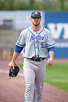 Hartford Yard Goats relief pitcher Matt Pierpont (55) walks to the dugout from the bullpen after a game against the Binghamton Rumble Ponies on July 9, 2017 at NYSEG Stadium in Binghamton, New York.  Hartford defeated Binghamton 7-3.  (Mike Janes/Four Seam Images)