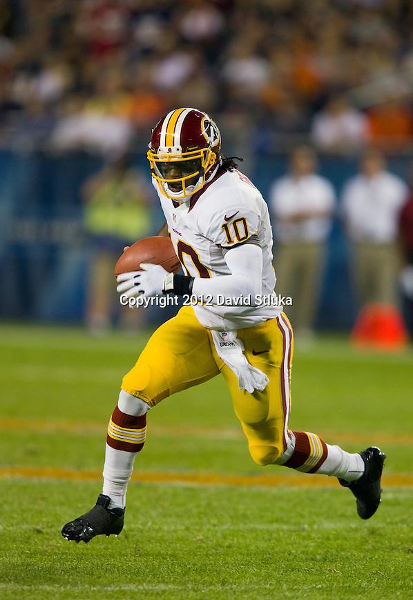 Washington Redskins quarterback Robert Griffin III (10) runs for yardage during an NFL preseason week 2 football game against the Chicago Bears on August 18, 2012 in Chicago. The Bears won 33-31. (AP Photo/David Stluka)