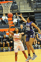 NWA Democrat-Gazette/FLIP PUTTHOFF <br /> Kayla Richardson (21) shoots for the Lady War Eagles while Jasmine Franklin (32) defends for the Lady Bulldogs.