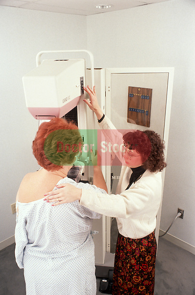 Woman prepares for mammogram