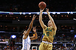 11 March 2016: Notre Dame's Rex Pflueger (0) shoots over North Carolina's Joel Berry II (2). The University of North Carolina Tar Heels played the University of Notre Dame Fighting Irish at the Verizon Center in Washington, DC in the Atlantic Coast Conference Men's Basketball Tournament semifinal and a 2015-16 NCAA Division I Men's Basketball game. UNC won the game 78-47.