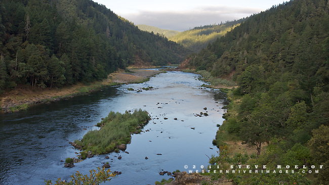 The morning sky reflects in the Rogue River.