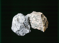 HORNBLENDE (GRAY) &amp; BIOTITE GNEISS (BROWN)<br /> With feldspar augen or eyes<br /> Metamorphic rock coarsely foliated w/banding caused by layers of quartz and dark minerals.  The large white spots are known as feldspar eyes.