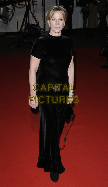 "PENNY DOWNIE.Attending the ""Invictus'"" UK Film Premiere at the Odeon West End cinema, Leicester Square, London, England, January 31st, 2010. .arrivals full length dress black velvet long maxi brooch bag .CAP/CAN.©Can Nguyen/Capital Pictures"