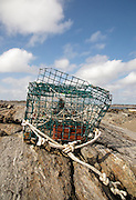 Lobster trap washed up on the shore in New Castle, New Hampshire USA during the spring months