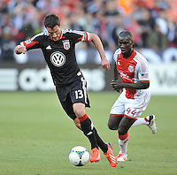 Chris Pontius(13) of D.C. United goes against Pa Modou Kah (44) of the Portland Timbers. The Portland Timbers defeated D.C. United 2-0, at RFK Stadium, Saturday May 25 , 2013.