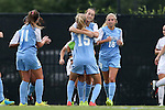 07 September 2014: North Carolina's Summer Green (center, behind) celebrates her goal with Katie Bowen (NZL) (15), Megan Buckingham (18) and Darcy McFarlane (11). The University of North Carolina Tar Heels played the University of Arkansas Razorbacks at Koskinen Stadium in Durham, North Carolina in a 2014 NCAA Division I Women's Soccer match. UNC won the game 2-1.